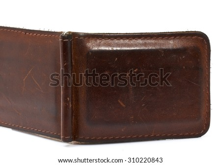 brown wallet with money on a white background.