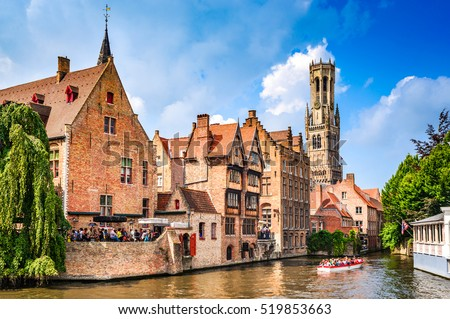 "BRUGES, BELGIUM - 7 August 2014: Scenery with water canal in Bruges, ""Venice of the North"", cityscape of Flanders, Belgium."