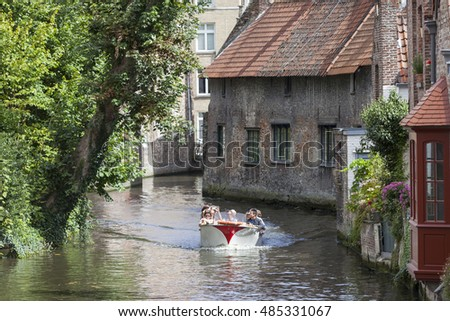 Bruges, Belgium, 28 august 2016: tourist boat in bruges canal on sunny summer day in august