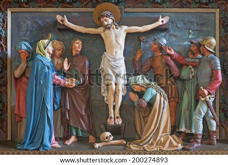 BRUGGE, BELGIUM - JUNE 13, 2014: Relief of Crucifixion of the cross in st. Giles (Sint Gilliskerk) as part of the Passion of Christ cycle.
