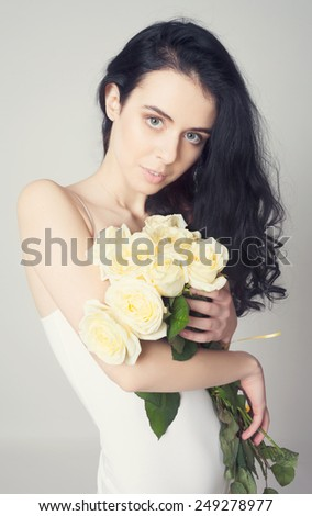 brunette woman with bouquet of rose