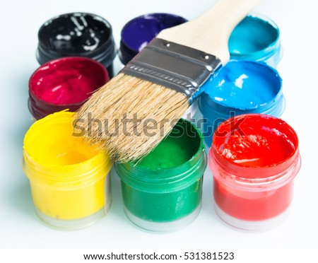 brush with a brightly colored paints