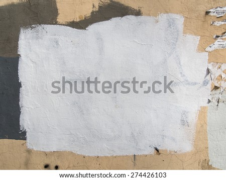 Brushstrokes of white paint covering the wall. Abstract background.