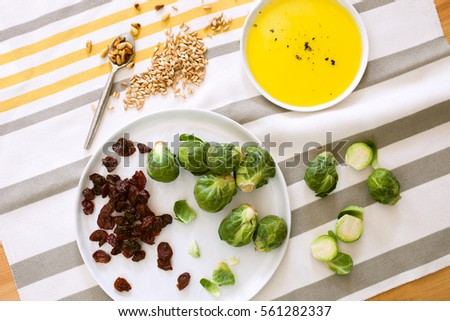 Brussel spouts with dried cherries, olive oil, sesame seeds and pine nuts