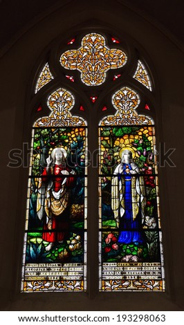 BRUSSELS, BELGIUM-APRIL 26, 2014: Stained glass window in neogothic Saint Barbara Church constructed in 1869 with image of St. Aloysius and St. Sophia.