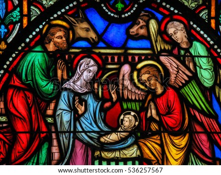 BRUSSELS, BELGIUM - JULY 26, 2012: Stained glass window depicting the Nativity Scene on Christmas in the cathedral of Brussels.