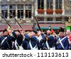 BRUSSELS, BELGIUM-SEPTEMBER 26: Unidentified performers in uniforms from 1830 shoot salute in ceremony on Grand Place during Celebrations of French Community on September 26, 2009 in Brussels, Belgium - stock photo