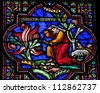 BRUSSELS - JULY 26: Stained glass window depicting Moses and the burning bush in the cathedral of Brussels on July, 26, 2012. - stock photo