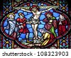 BRUSSELS - JUNE 22: Crucifixion from windowpane in st. Michael s gothic cathedral on June 22, 2012 in Brussels. - stock photo