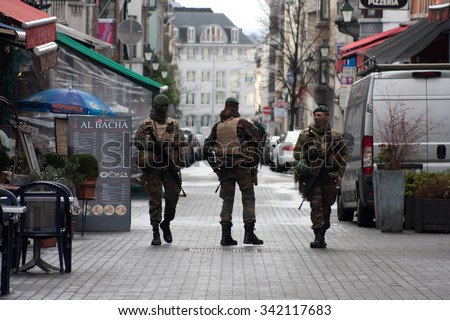 BRUSSELS - NOVEMBER 22: Belgium Army patrolling on a street near Avenue Louise in the city center of Brussels on November 22, 2015 in Brussels, Belgium.