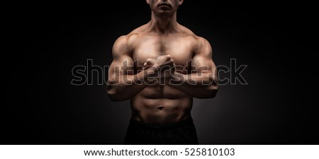 Brutal man bodybuilder man on black background