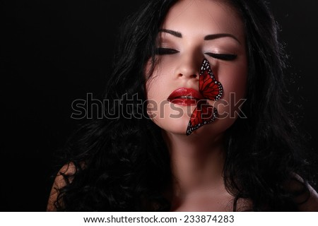 Buatiful woman with make up and red butterflys