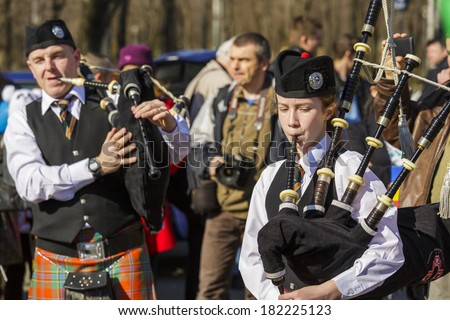 BUCHAREST - MARCH 16: Traditional Irish bagpipe band celebrate the 2nd edition of St. Patrick's Day Parade on March 16, 2014 in Bucharest, Romania.