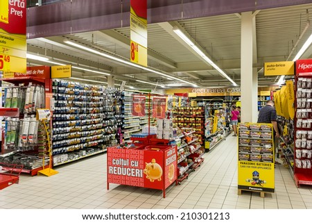 BUCHAREST, ROMANIA - AUGUST 10, 2014: Electronic Products For Sale In Supermarket Aisle.