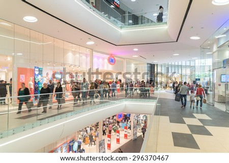 BUCHAREST, ROMANIA - JULY 14, 2015: People Crowd Rush In Shopping Luxury Mall Interior.