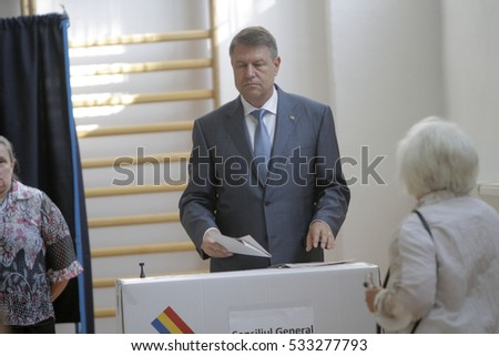 BUCHAREST, ROMANIA - MAY 05, 2016: Romanian President Klaus Iohannis casts his vote in local elections.