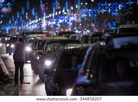 Bucharest, Romania â?? November 30, 2014: Nightscene in Bucharest center when the Christmas lights and decorations are on.