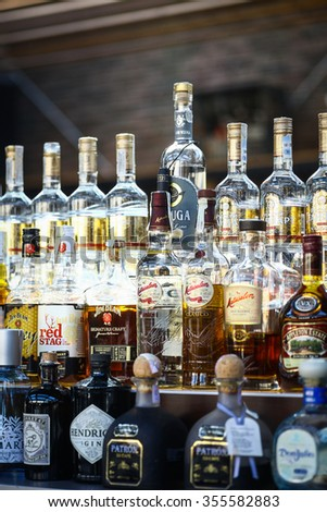 Bucharest, Romania - September 9, 2015: Several types of bottled alcohol are displayed on some shelves in a pub in Bucharest, Romania.