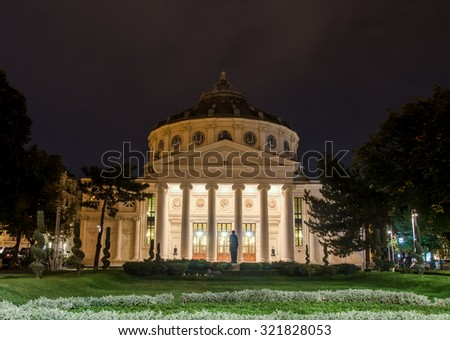 "BUCHAREST, ROMANIA - SEPTEMBER 26, 2015. The neoclassical building called ""Ateneul Roman"" (Atheneum) usual place to host classical shows. George Enescu Festival. Night time."