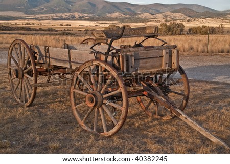 Buckboard at sunset with mountains in the background