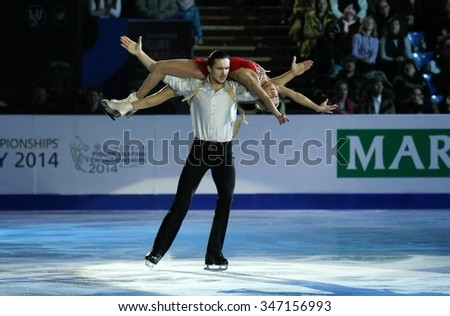 BUDAPEST, HUNGARY - JANUARY 19, 2014: Tatiana VOLOSOZHAR / Maxim TRANKOV perform during the exhibition gala at ISU European Figure Skating Championship in Syma Hall Arena.
