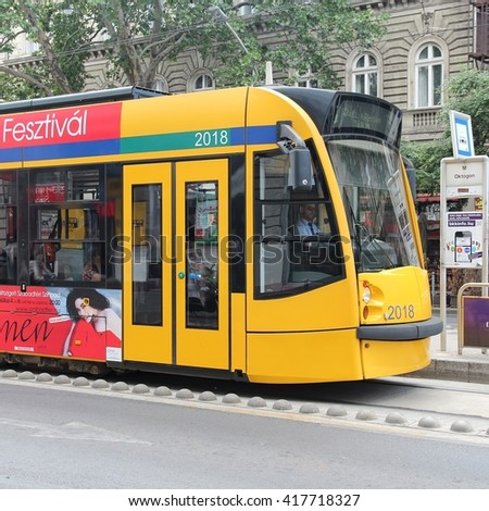BUDAPEST, HUNGARY - JUNE 19, 2014: People ride tram in Budapest. It is part of BKK public transport system which serves 1.4 billion annual rides (2011).