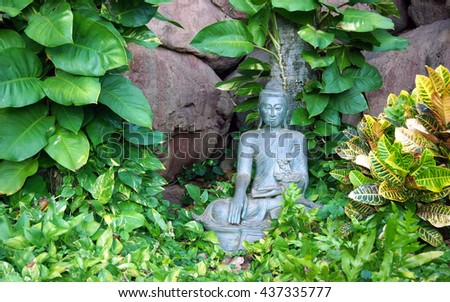 Buddha sculpture in zen garden, Maui, Hawaii