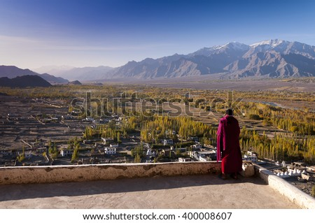 Buddhist monk looks from the Tikse monastery to the Indus valley, Ladakh, India