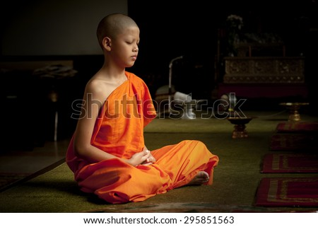 Buddhist monk meditation in temple.