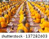 Buddhist monks pray to Buddha and candles in Chiang Rai - stock photo