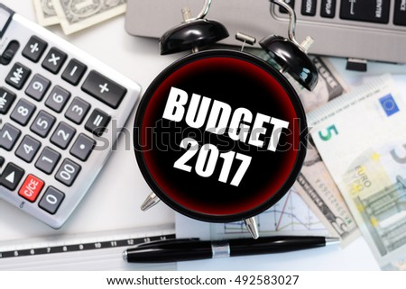 Budget exercise 2017 or forecast with old clock and office materials concept