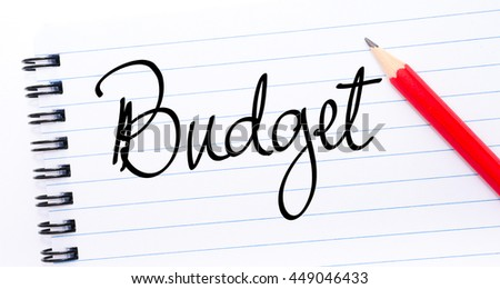 Budget written on notebook page with red pencil on the right