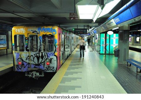 BUENOS AIRES, ARGENTINA-APRIL 11: Metro train stands by the platform on Retiro station on April 11, 2013 in Buenos Aires, Argentina. Metro of Buenos Aires is more then 100 years age.