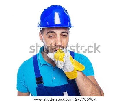 Builder yawning over isolated white background. Construction worker is sleepy
