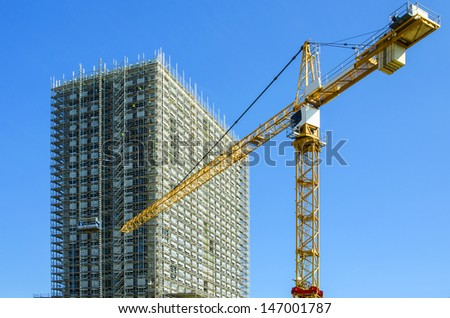 Building construction site with crane