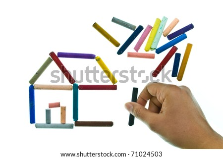 Building house with pastel sticks