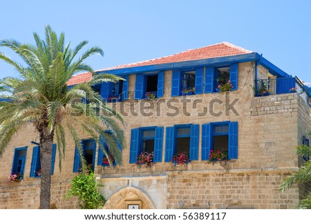 building with blue shutters in old jaffa