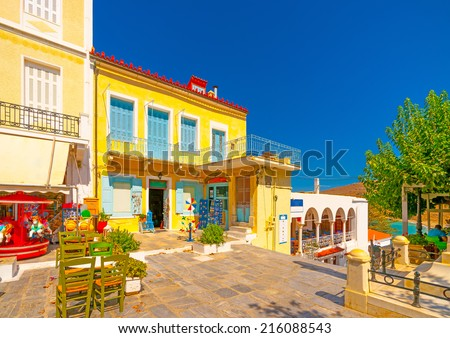 buildings and shops located around the main square of Chora, the capital of Andros island in Greece