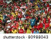 BUKIT JALIL, MALAYSIA - JULY 13: Soccer fans cheer during the Arsenal vs Malaysia game in the National Stadium on July 13, 2011, Bukit Jalil, Malaysia. English league team Arsenal is on an Asia Tour. - stock photo