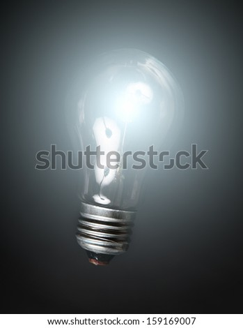 Bulb light over black background