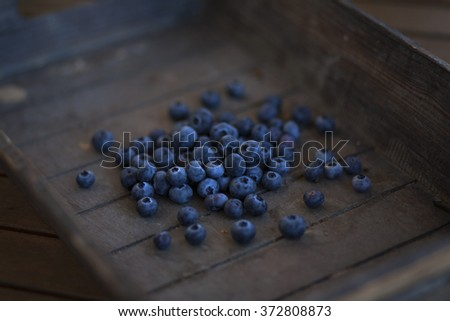 bunch of blueberries in a wooden basket