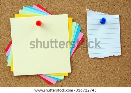 Bunch of empty sticky notes on cork board