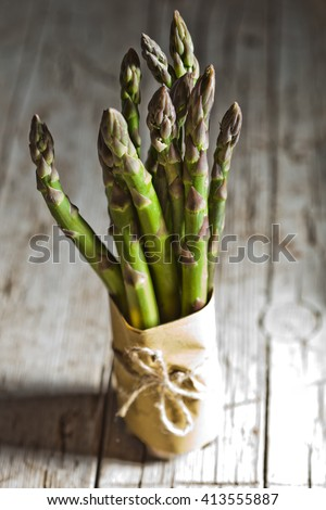 bunch of fresh asparagus closeup on wooden table
