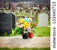 Bunch of fresh colorful flowers at a cemetery - stock photo