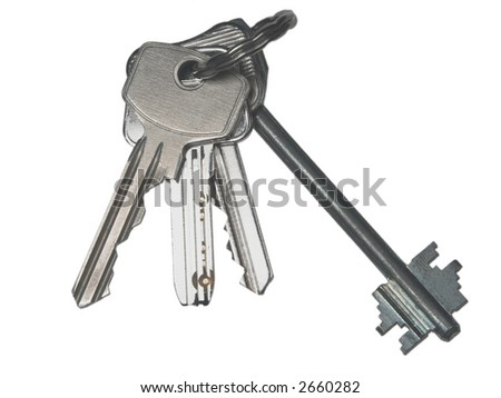 Bunch of metal modern keys on a ring, isolated on white
