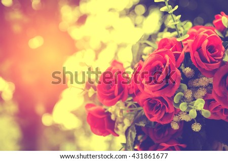 bunch of red rose flower on table with nature blur background
