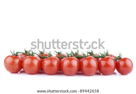 Bunch of ripe red cherry tomatoes isolated on white
