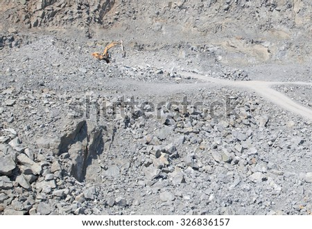 Burgas - August 29: Excavator extraction of quarry stone blocks for construction needs on August 29, 2015 Bourgas, Bulgaria
