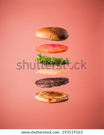 Burger floating on wood table stock photo 533743870 for Table burger