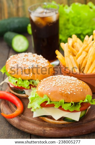 Burger with fries and cola